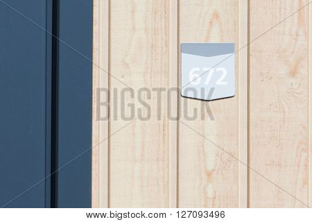 672 street number on a wooden bungalow