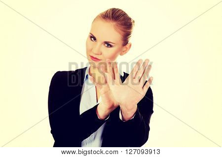 Young business woman trying to protect herself
