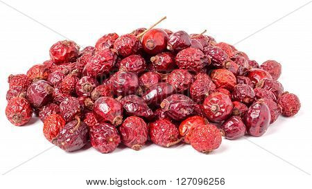 pile of dried rose hips isolated on a white background.