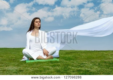 Girl Sitting Relaxed On The Grass