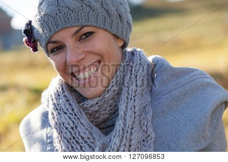 closeup of a woman with wool cap and scarf in campaign