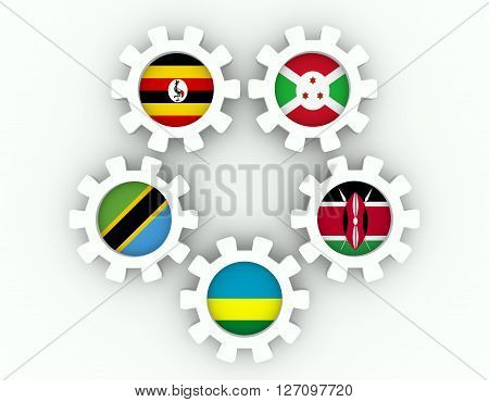East African Community EAC association of five national economies members flags on gear. Global teamwork. 3D rendering White background