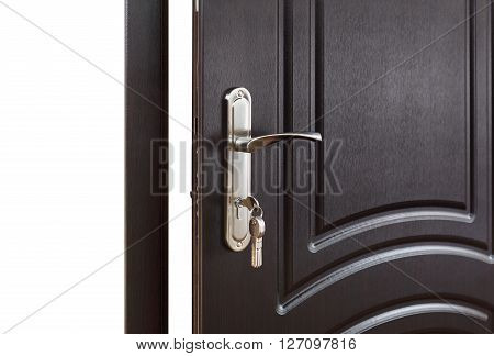 Closed door handle. Door lock with keys. Dark brown wooden door closeup. Modern interior design, door handle. New house concept. Real estate.