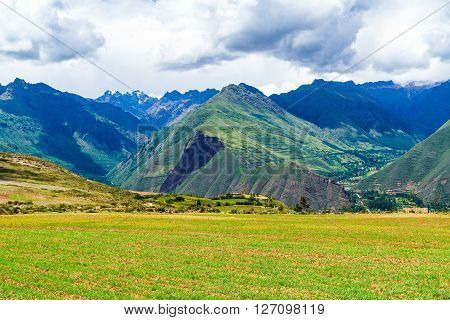 View of mountain and the village in the Secred Valley of the Incas in Peru