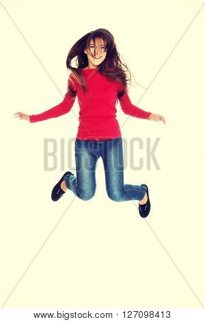 Young woman student jumping.