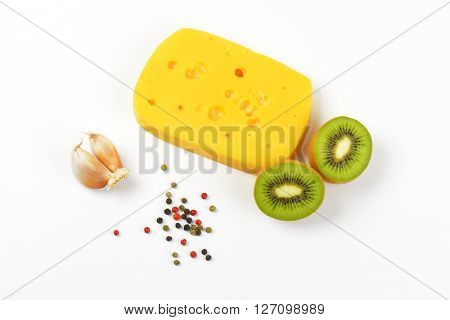 emmental cheese with garlic and kiwi on white background
