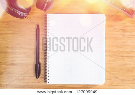 wooden table with office related objects, modern stylish work place, view from above