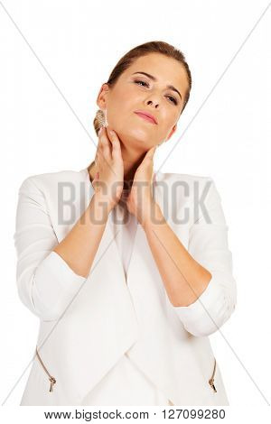 Businesswoman with terrible throat pain