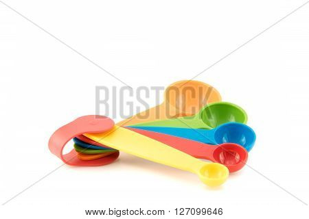Plastic Measuring Spoons Set On White Background