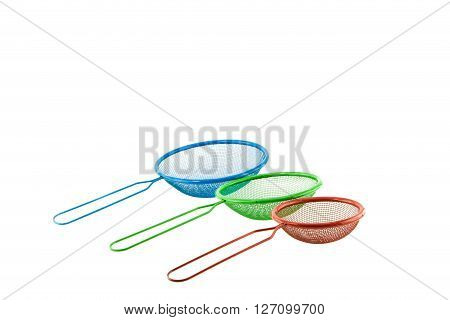 three Plastic sieve set on white background