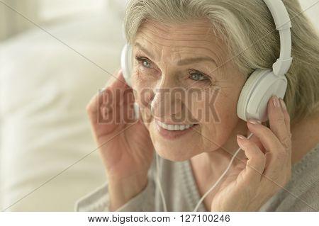 Portrait of a senior woman in headphones