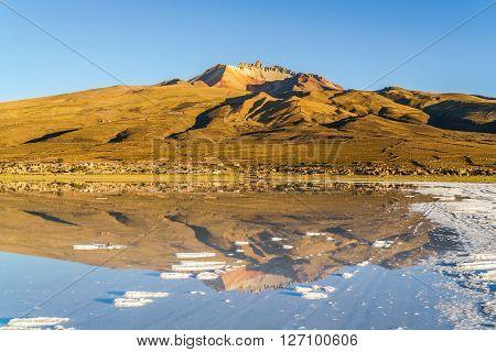 Dormant volcano and Coqueza Village at Solar De Uyuni in Bolivia