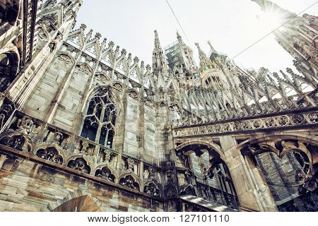 Detail of Milan cathedral - Duomo di Milano Italy. Architectural theme. Cultural heritage. Big church. Sun rays. Candoglia marble.