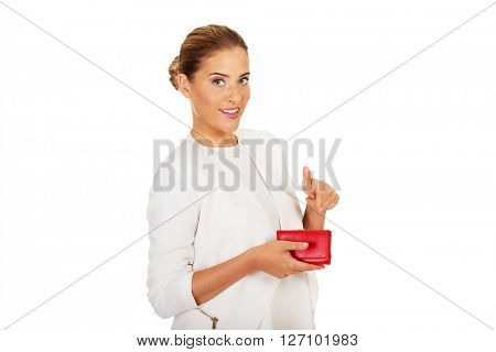 Beautiful happy businesswoman holding red wallet
