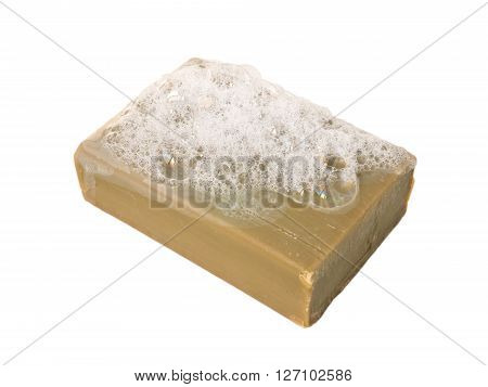 Natural olive oil soap bar with lather isolated on white