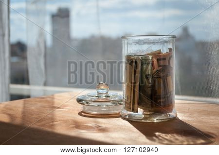 money in the jars on the table savings for vacation