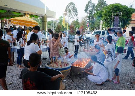 BANGKOK THAILAND - APRIL 15 2016 : People praying respect to the monk in Songkran Festival on April 15 2016 in Bangkok Thailand.