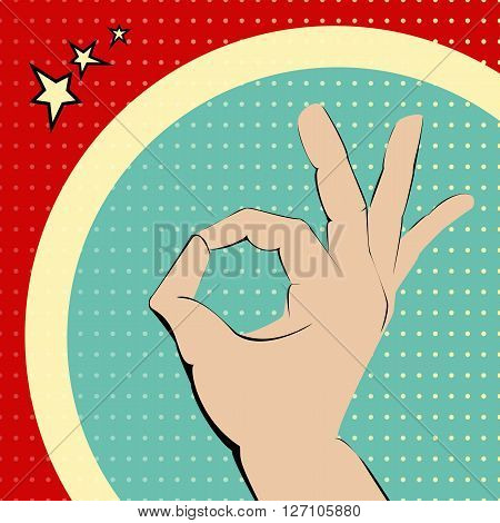 Ok hand on red and turquois spotted background.