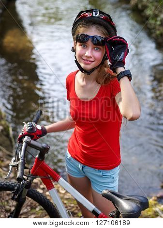 Bikes bicycling girl cycling fording throught water .