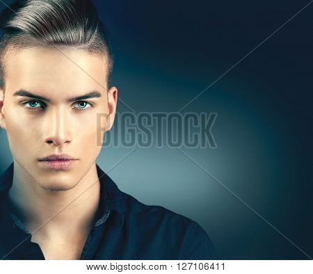 High Fashion Model Man Portrait Isolated On Dark Background