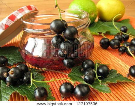 Cold stirred black currant jam and fresh fruits