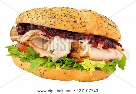 Roast turkey and salad sandwich with cranberry jelly isolated on a white background