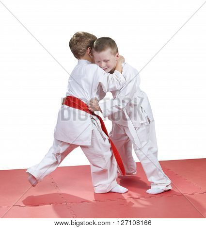 Young children are trained judo sparring in kindergarten
