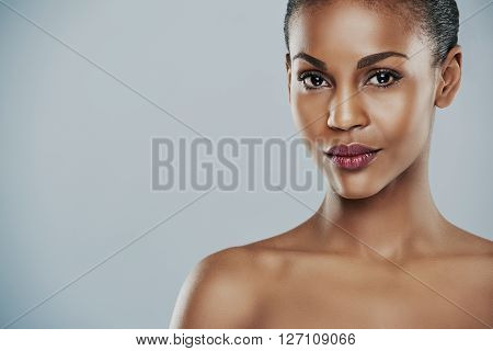 Woman With Seductive Expression On Gray Background