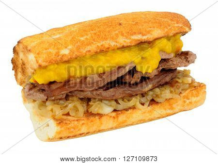 Fried beef steak and onion sandwich with mustard pickle relish in a toasted bread baton isolated on a white background
