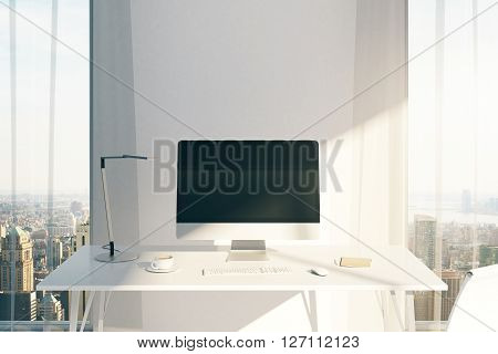 Creative desktop with blank computer screen in sunlit office with windows and city view. Mock up 3D Rendering