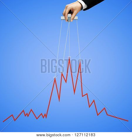 Businessman hand manipulating graph on blue background