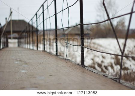 the fence of the old metal bridge over the Creek