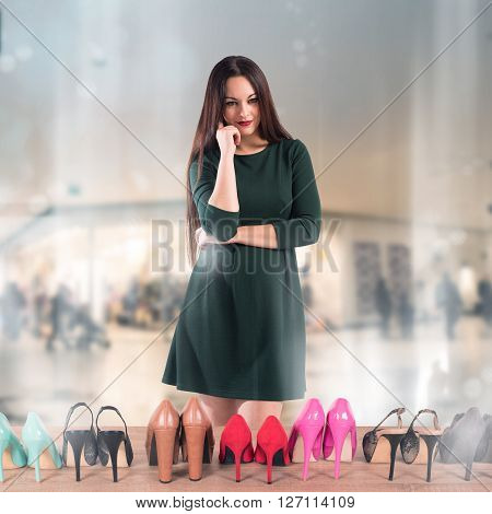 Woman undecided in front of shoes showcase