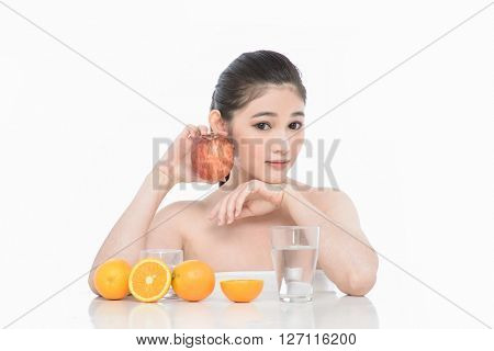 Happy Young Woman with apple. Concept vegetarian dieting - healthy food