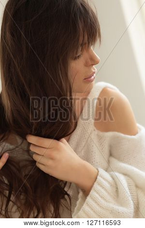 Woman with dark untangles hair. Natural portrait.