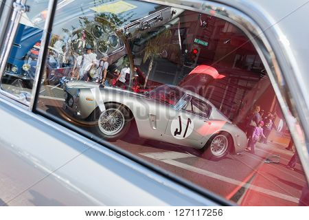 Vintage Ferrari In The Reflection Of Car Window