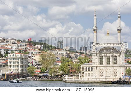 ISTANBUL,TURKEY, APRIL 21, 2016: Exterior shot of Ortakoy Mosque and Ortakoy, a neighbourhood, formerly a small village, within the Besiktas district of Istanbul, Turkey.