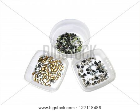 Three semi transparent containers with assorted computer screws on white