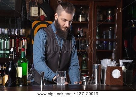 This is photo of barman at work on his workplace.