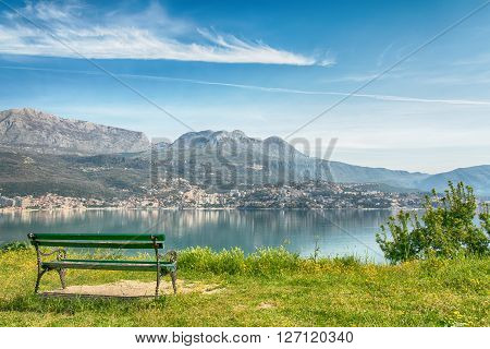 View on sea and mountains with bench on foreground, HDR