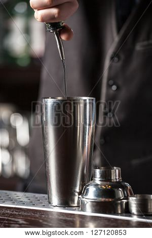 This is closeup of barman making a cocktails.