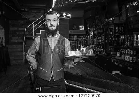 Happy Handsome Waiter Holding A Tray.