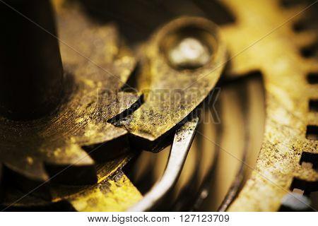 Close Up Of Cogs Inside A Clock