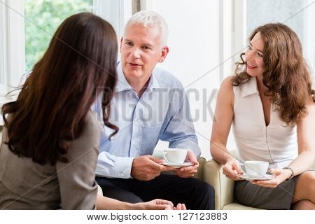 Adviser giving investment and retirement advice to senior woman and man