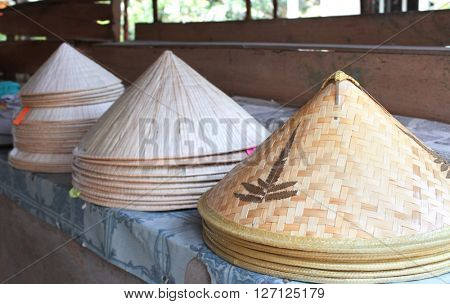 Asian conical wide-brimmed rain hats for sale