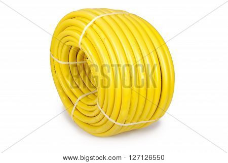 Garden water hose rolled up in a tangle isolated on white