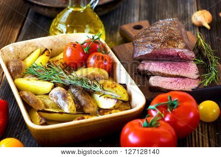 Delicious Beef Steak With Potato On Wooden Background.
