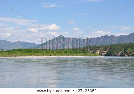 floating down the Indigirka River , the beautiful views of the mountains and forests in the taiga