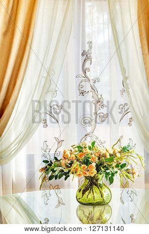 Bouquet Of Roses In A Transparent Green Vase