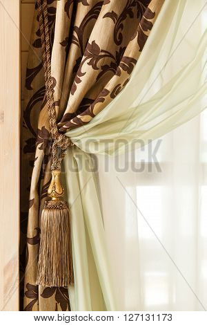 Richly Decorated Curtain With A Holding Strap